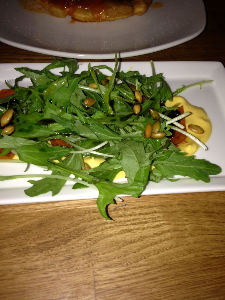Roasted pumpkin salad with arugula and huckelberru